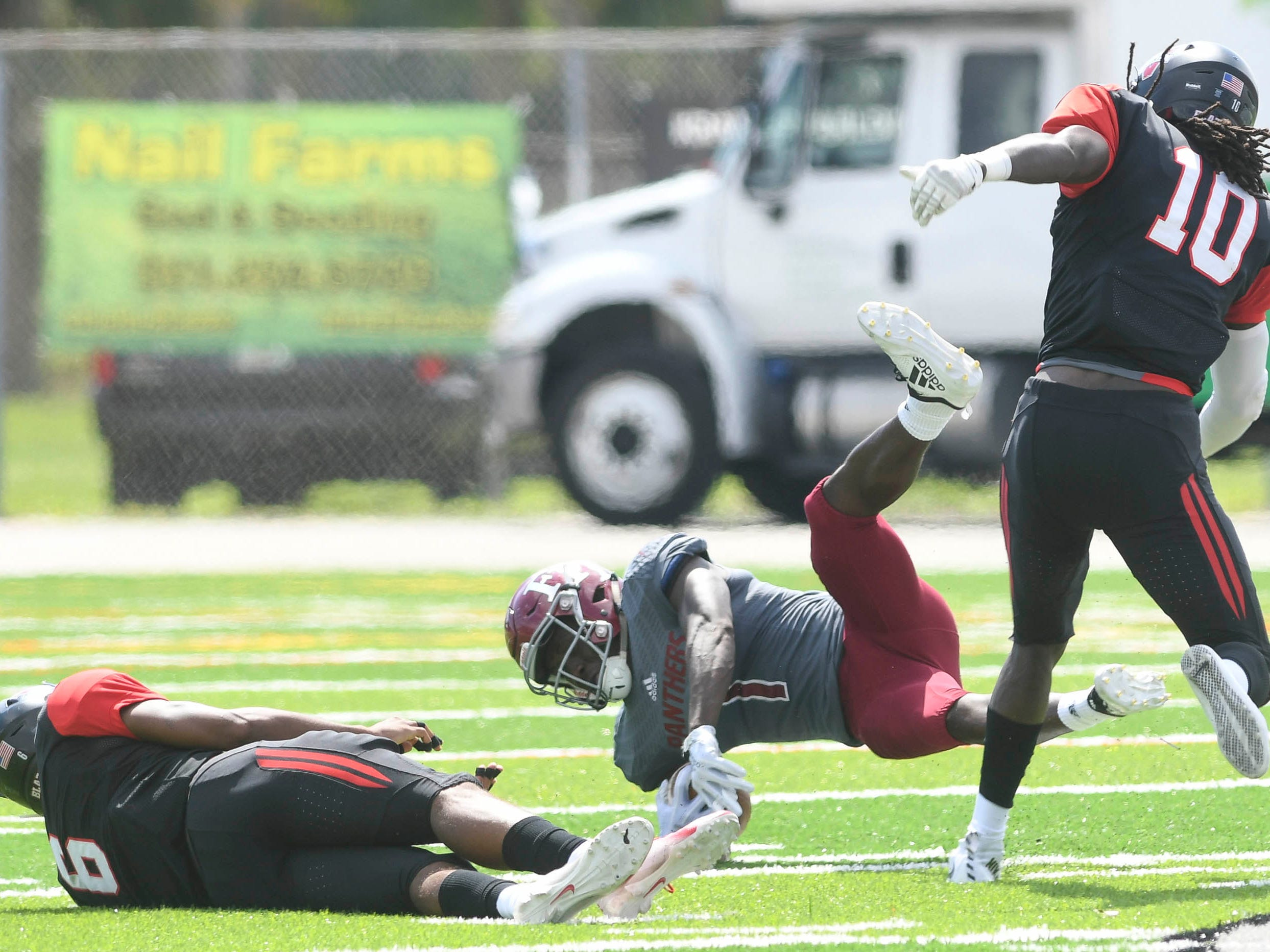 Romell Guerrier of Florida Tech catches a pass over the defense of Ravarius Rivers (6) and Stephen Denmark of Valdosta State during Saturday's game.