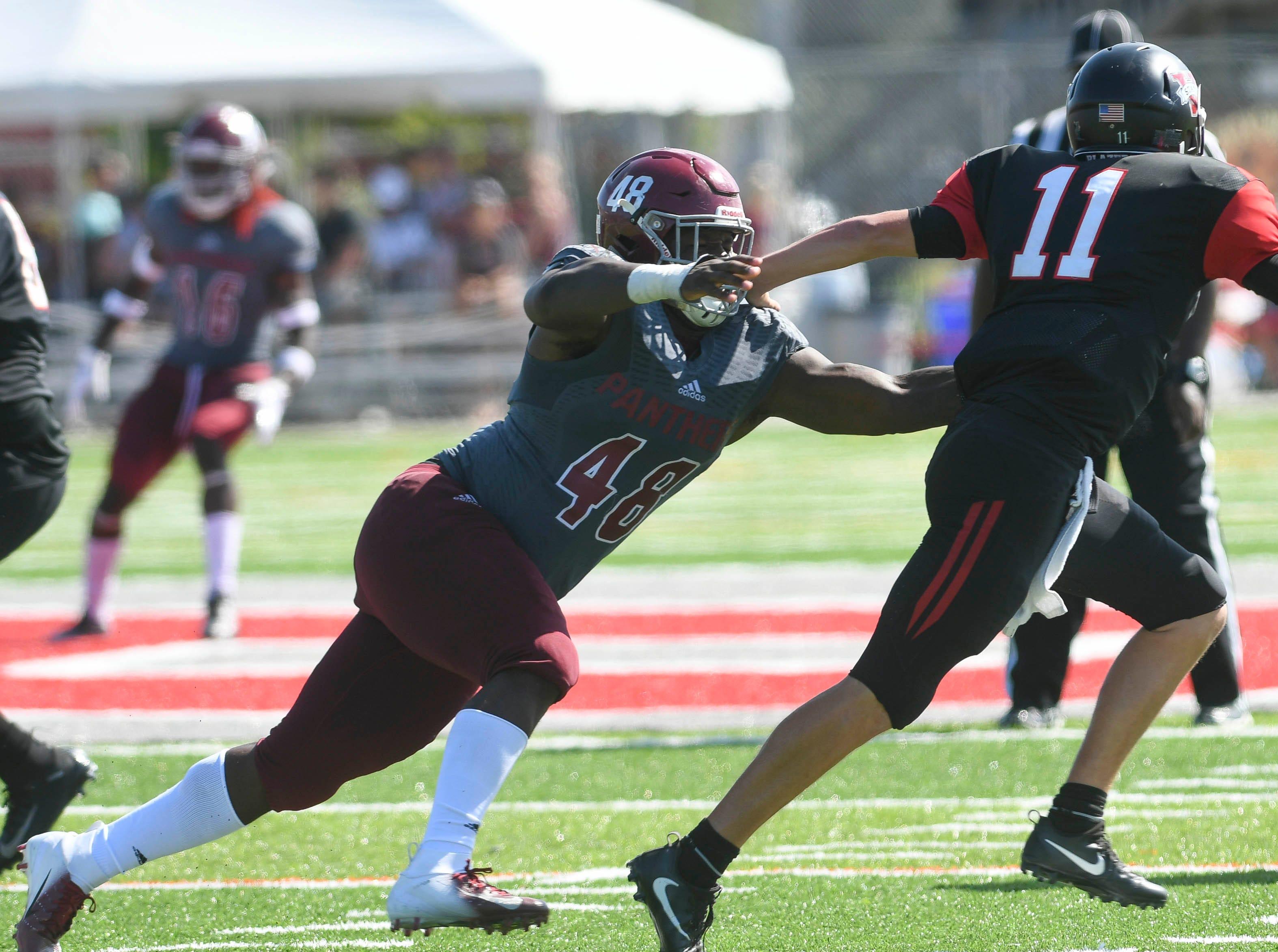 Adonis Davis of Florida Tech pursues Valdosta St. QB Rogan Wells during Saturday's game.