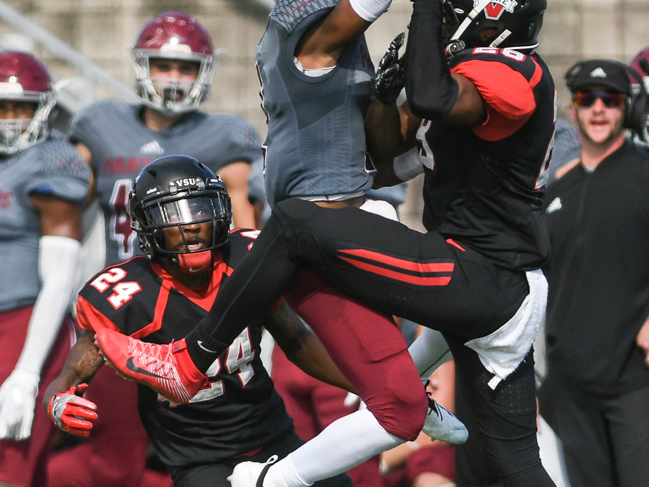 Brian Spurgeon (2) of Florida Tech and Raymond Palmer of Valdosta State contend for a pass during Saturday's game. Alex Brown of Valdosta State (24) will eventually end up with the interception.