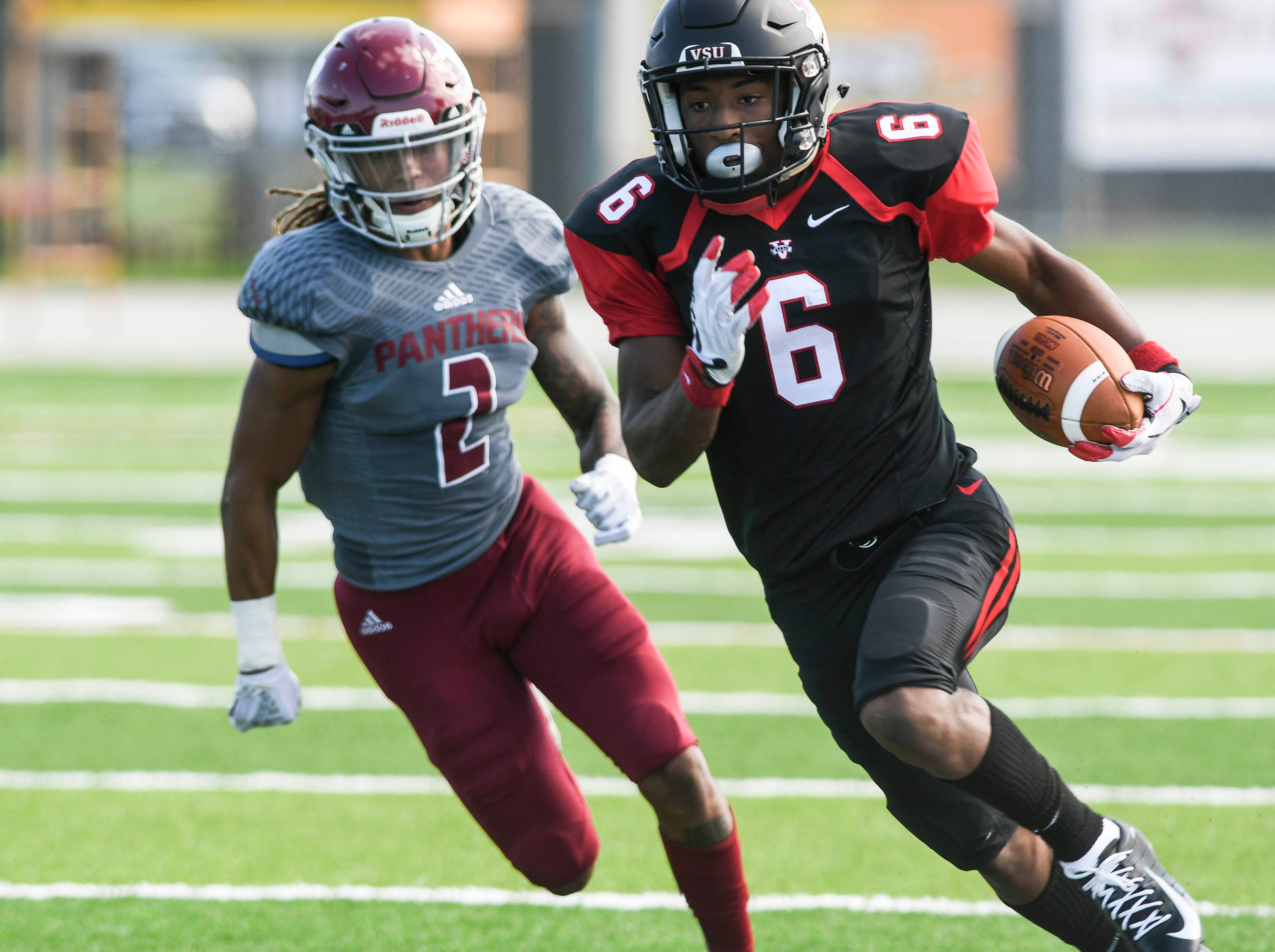 Lio'undre Gallimore of Valdosta State is pursued by DeVontae Weekley of Florida Tech during Saturday's game.