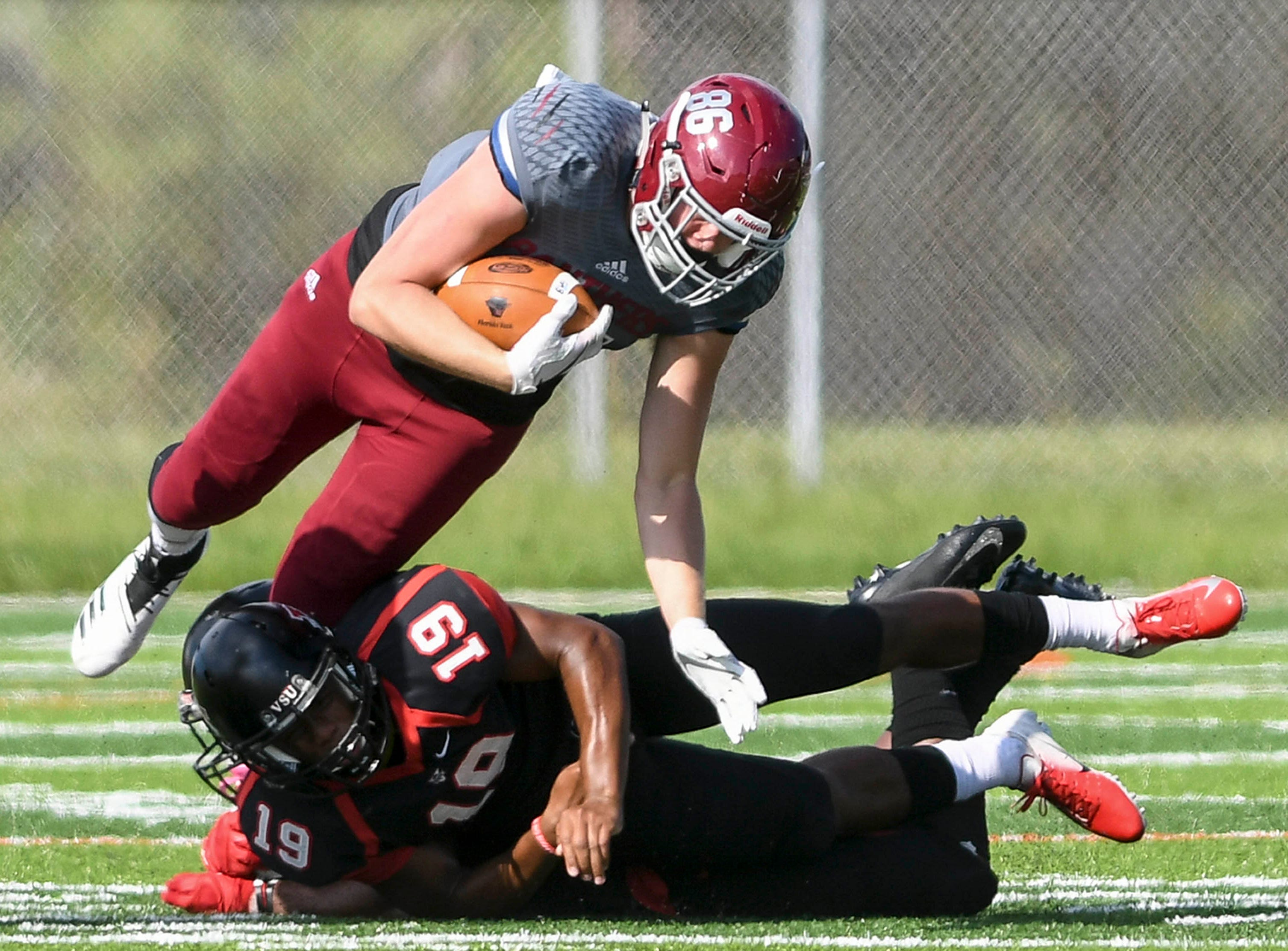 Kenny Hiteman of Florida Tech is taken down by Cory Roberts of Valdosta State during Saturday's game.