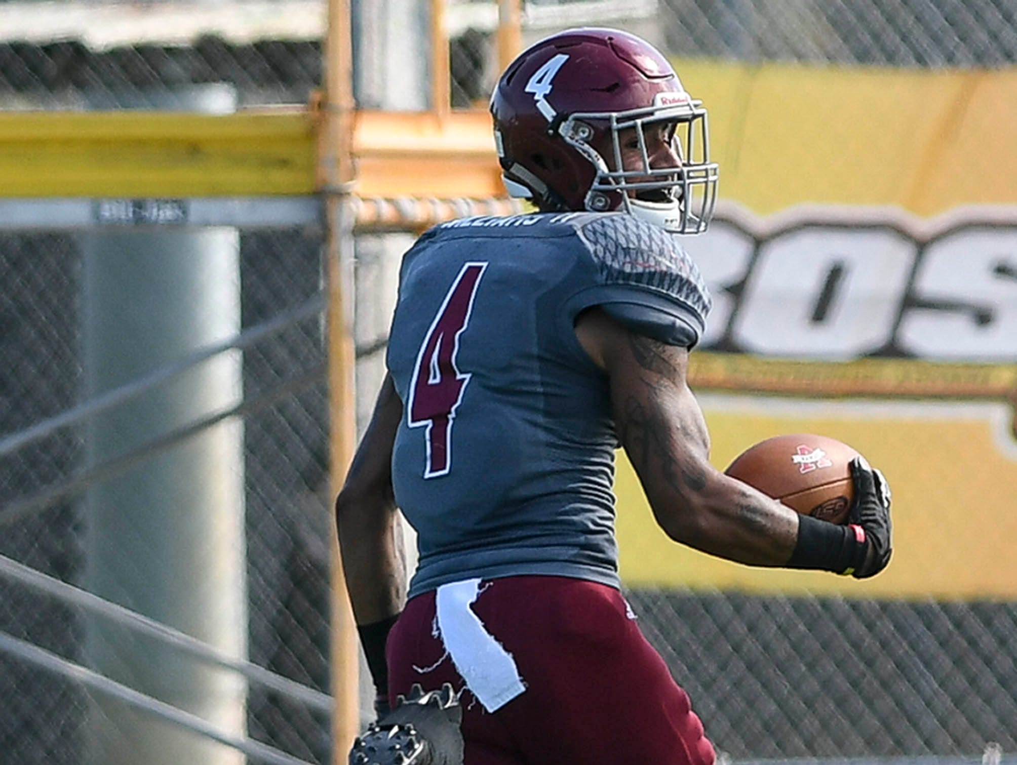 Simon WIlliams of Florida Tech recovers a fumble and takes it to the end zone for a touchdown during Saturday's game.