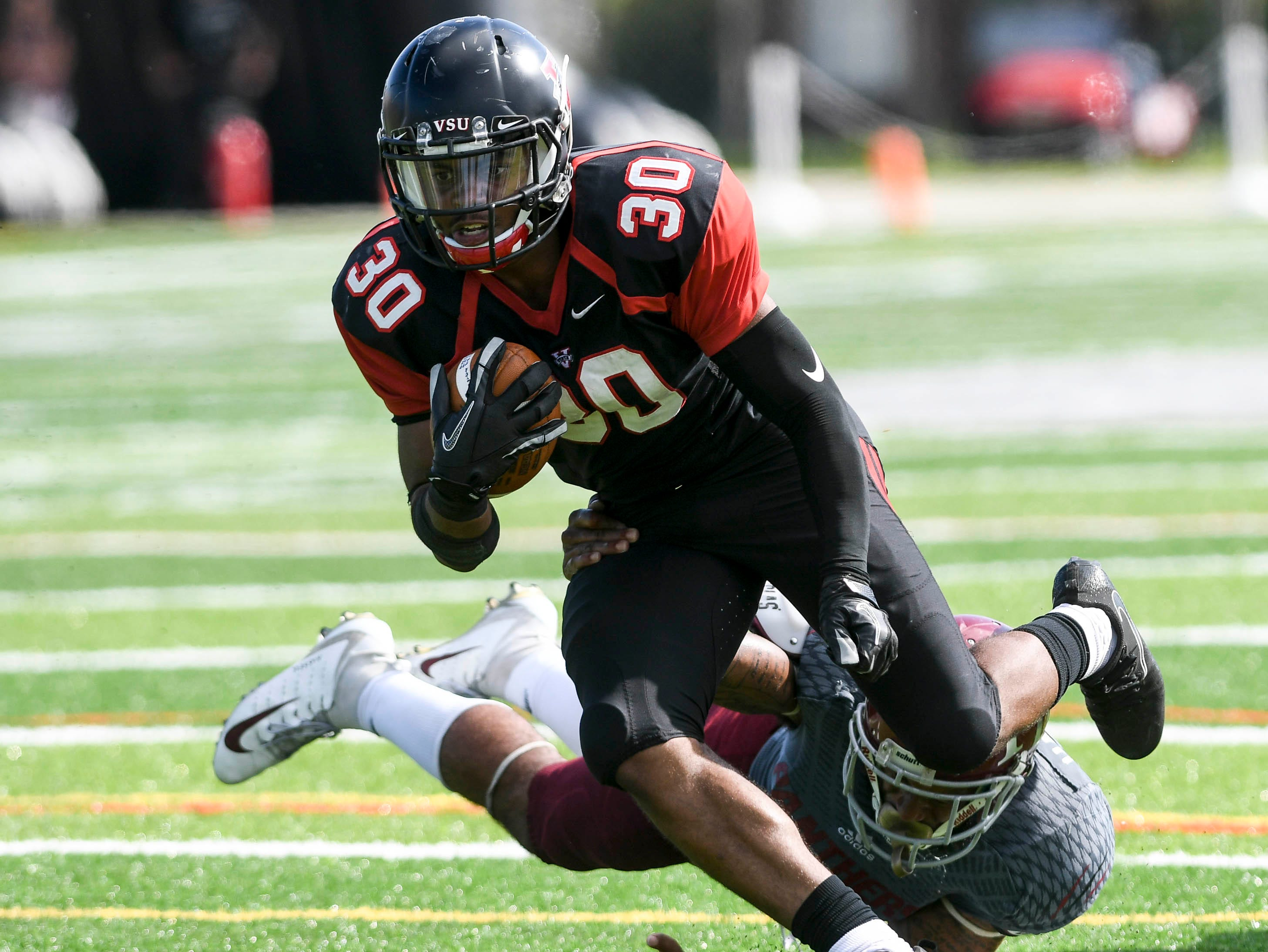 Seth McGill of Valdosta State gets past Florida Tech's JT Hassell and scores a touchdown during Saturday's game.
