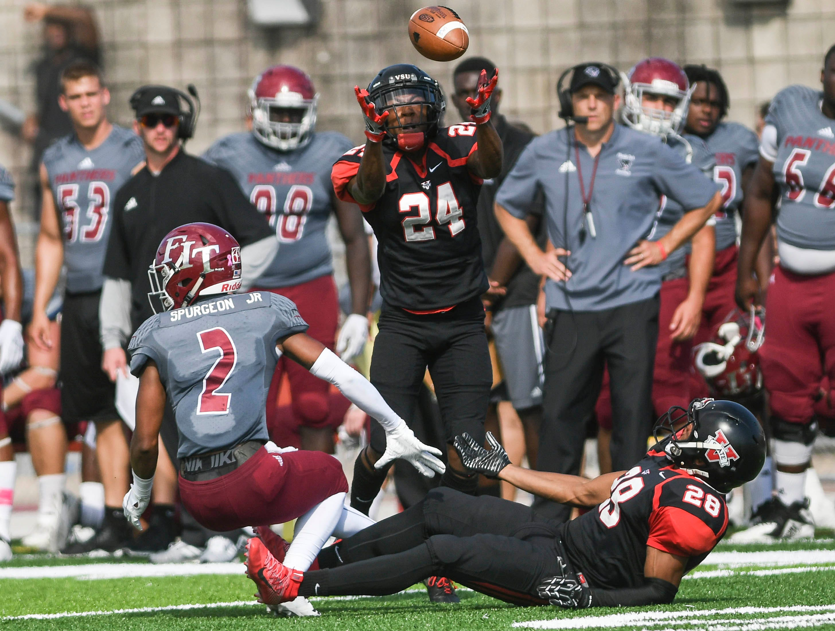 Alex Brown of Valdosta State (24) intercepts a pass intended for Brian Spurgeon (2) of Florida Tech during Saturday's game. Also defending for Valdosta State is Raymond Palmer (28).