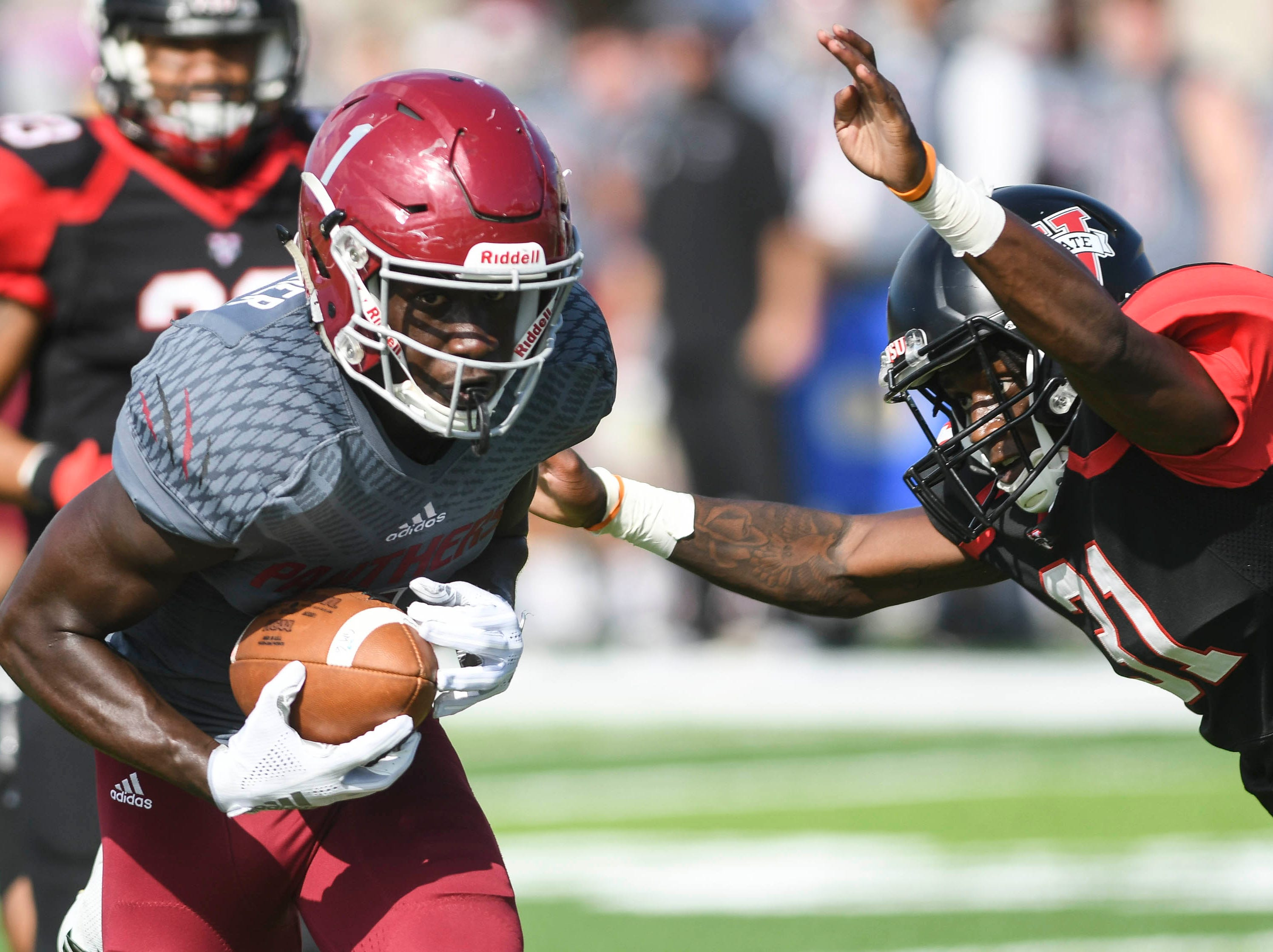 Aaron Dawson of Valdosta State tackles Romell Guerrier of Florida Tech but not before he scores a touchdown on as pass from Trent Chmelik during Saturday's game.
