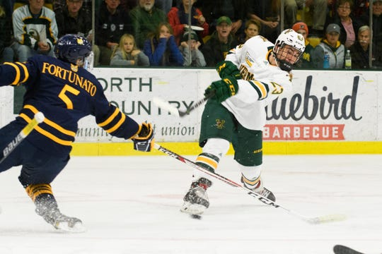 Vermont forward Max Kaufman (23) shoots the puck during the men's hockey game between the Quinnipiac Bobcats and the Vermont Catamounts at Gutterson Field House on Saturday night October 13, 2018 in Burlington. (BRIAN JENKINS/for the FRESS PRESS)