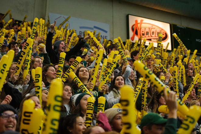 Fans cheer for Vermont during the men's hockey game between the Quinnipiac Bobcats and the Vermont Catamounts at Gutterson Field House on Saturday night October 13, 2018 in Burlington. (BRIAN JENKINS/for the FRESS PRESS)