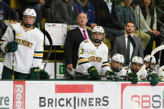 Vermont head coach Kevin Sneddon and the bench watches the action on the ice during the men's hockey game between the Quinnipiac Bobcats and the Vermont Catamounts at Gutterson Field House on Saturday night October 13, 2018 in Burlington. (BRIAN JENKINS/for the FRESS PRESS)