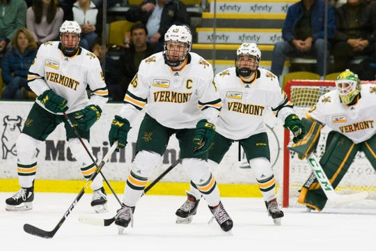 Vermont forward Derek Lodermeier (16), Vermont forward Max Kaufman (23), Vermont defenseman Christian Evers (5) and Vermont goalie Stefanos Lekkas (40) keep an eye on the puck during the men's hockey game between the Quinnipiac Bobcats and the Vermont Catamounts at Gutterson Field House on Saturday night October 13, 2018 in Burlington. (BRIAN JENKINS/for the FRESS PRESS)