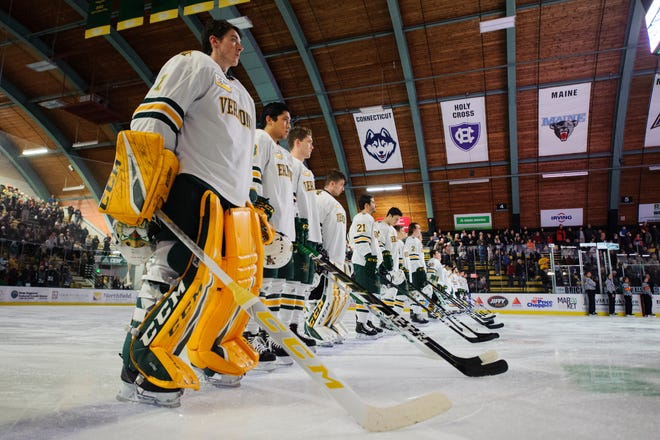 Vermont listens to the National Anthem during the men's hockey game between the Quinnipiac Bobcats and the Vermont Catamounts at Gutterson Field House on Saturday night October 13, 2018 in Burlington. (BRIAN JENKINS/for the FRESS PRESS)