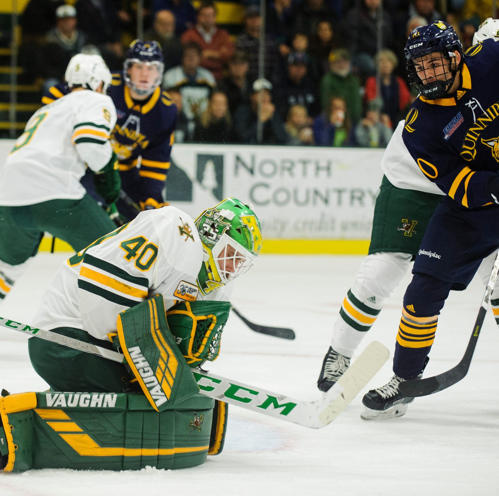 Vermont goalie Stefanos Lekkas (40) makes a save during the men's hockey game between the Quinnipiac Bobcats and the Vermont Catamounts at Gutterson Field House on Saturday night October 13, 2018 in Burlington. (BRIAN JENKINS/for the FRESS PRESS)