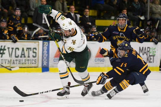 Vermont forward Derek Lodermeier (16) skates past Quinnipiac's Chase Priskie (13) with the puck during the men's hockey game between the Quinnipiac Bobcats and the Vermont Catamounts at Gutterson Field House on Saturday night October 13, 2018 in Burlington. (BRIAN JENKINS/for the FRESS PRESS)
