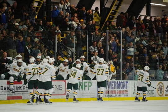 Vermont celebrates a goal during the men's hockey game between the Quinnipiac Bobcats and the Vermont Catamounts at Gutterson Field House on Saturday night October 13, 2018 in Burlington. (BRIAN JENKINS/for the FRESS PRESS)