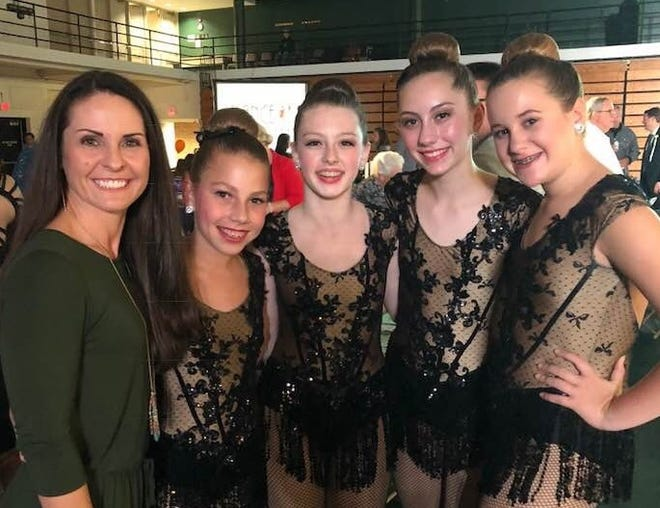 Kelly Prater poses with her surprise stand-ins, left to right, Josie Vallette, Karson Decamp, Caitlin Pennington, and Kaylee Norman,  a national award winning quartet from Transitions School of Dance.