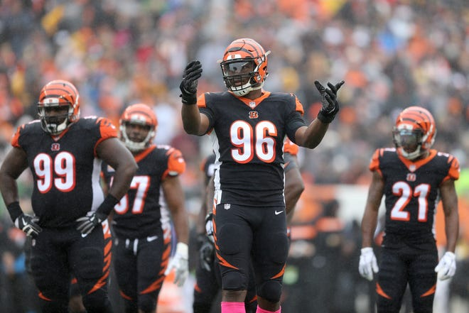 Cincinnati Bengals defensive end Carlos Dunlap (96) pumps up the crowd in the second quarter during the Week 6 NFL game between the Pittsburgh Steelers and the Cincinnati Bengals, Sunday, Oct. 14, 2018, at Paul Brown Stadium in Cincinnati. It was tied 14-14 at the half.