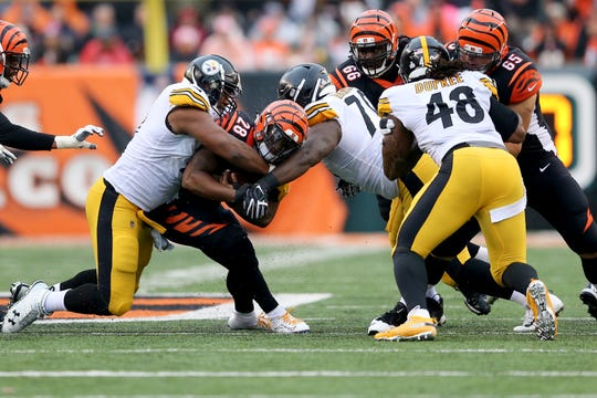 Cincinnati Bengals running back Joe Mixon (28) is stopped on a run in the fourth quarter during the Week 6 NFL game between the Pittsburgh Steelers and the Cincinnati Bengals, Sunday, Oct. 14, 2018, at Paul Brown Stadium in Cincinnati. The Pittsburgh Steelers won 28-21.