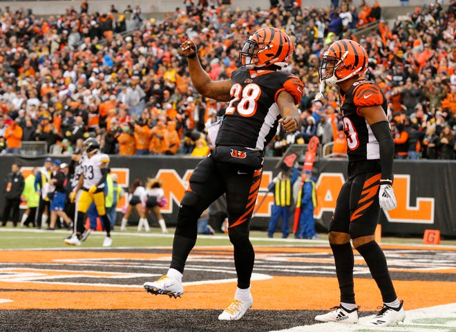 Cincinnati Bengals running back Joe Mixon (28) celebrates after running in a go-ahead touchdown in the fourth quarter of the NFL Week 6 game between the Cincinnati Bengals and the Pittsburgh Steelers at Paul Brown Stadium in downtown Cincinnati on Sunday, Oct. 14, 2018. The Bengals and Steelers exchanged late touchdowns, with the Pittsburgh coming out on top, 28-21.