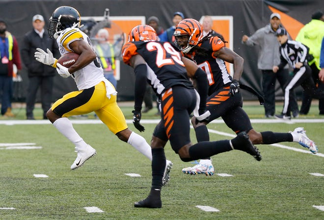 Pittsburgh Steelers wide receiver Antonio Brown (84) outruns the Bengals secondary for a game-winning touchdown in the fourth quarter of the NFL Week 6 game between the Cincinnati Bengals and the Pittsburgh Steelers at Paul Brown Stadium in downtown Cincinnati on Sunday, Oct. 14, 2018. The Bengals and Steelers exchanged late touchdowns, with the Pittsburgh coming out on top, 28-21.