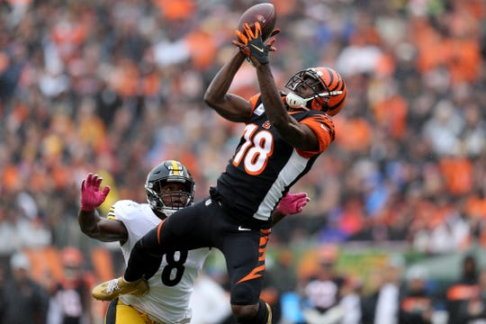 Cincinnati Bengals wide receiver A.J. Green (18) completes a catch in the third quarter during the Week 6 NFL game between the Pittsburgh Steelers and the Cincinnati Bengals, Sunday, Oct. 14, 2018, at Paul Brown Stadium in Cincinnati. It was tied 14-14 at the half.