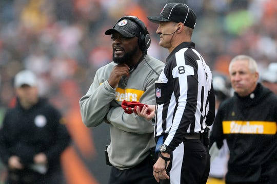 Pittsburgh Steelers head coach Mike Tomlin talks the line judge Dana McKenzie (8) in the second quarter during the Week 6 NFL game between the Pittsburgh Steelers and the Cincinnati Bengals, Sunday, Oct. 14, 2018, at Paul Brown Stadium in Cincinnati. It was tied 14-14 at the half.