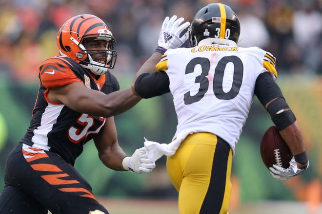 Cincinnati Bengals linebacker Vincent Rey (57) chases Pittsburgh Steelers running back James Conner (30) in the fourth quarter during the Week 6 NFL game between the Pittsburgh Steelers and the Cincinnati Bengals, Sunday, Oct. 14, 2018, at Paul Brown Stadium in Cincinnati. The Pittsburgh Steelers won 28-21.