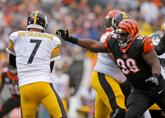 Cincinnati Bengals defensive tackle Andrew Billings (99) rushed Pittsburgh Steelers quarterback Ben Roethlisberger (7) out of the pocket in the first quarter of the NFL Week 6 game between the Cincinnati Bengals and the Pittsburgh Steelers at Paul Brown Stadium in downtown Cincinnati on Sunday, Oct. 14, 2018. The game was tied 14-14 at half time.