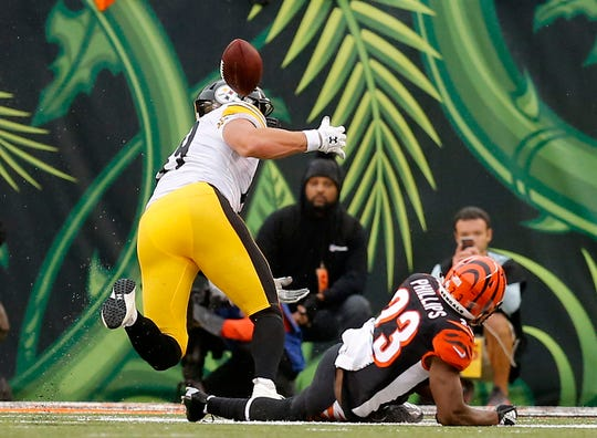 Pittsburgh Steelers tight end Vance McDonald (89) fumbles the ball as he's brought down by Cincinnati Bengals cornerback Darius Phillips (23) in the fourth quarter of the NFL Week 6 game between the Cincinnati Bengals and the Pittsburgh Steelers at Paul Brown Stadium in downtown Cincinnati on Sunday, Oct. 14, 2018. The Bengals and Steelers exchanged late touchdowns, with the Pittsburgh coming out on top, 28-21.