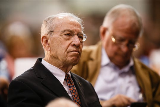 Sen. Chuck Grassley watches as White House Spokesperson Sarah Sanders speaks during Gov. Reynolds Harvest Festival at the Knapp Animal Learning Center on Saturday, Oct. 13, 2018, in Des Moines.