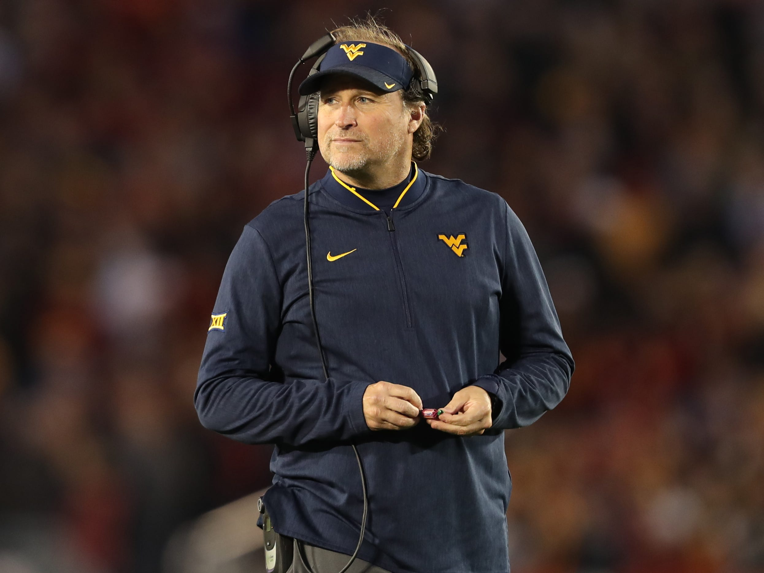 West Virginia Mountaineers head coach Dana Holgorsen watches his team against the Iowa State Cyclones at Jack Trice Stadium.