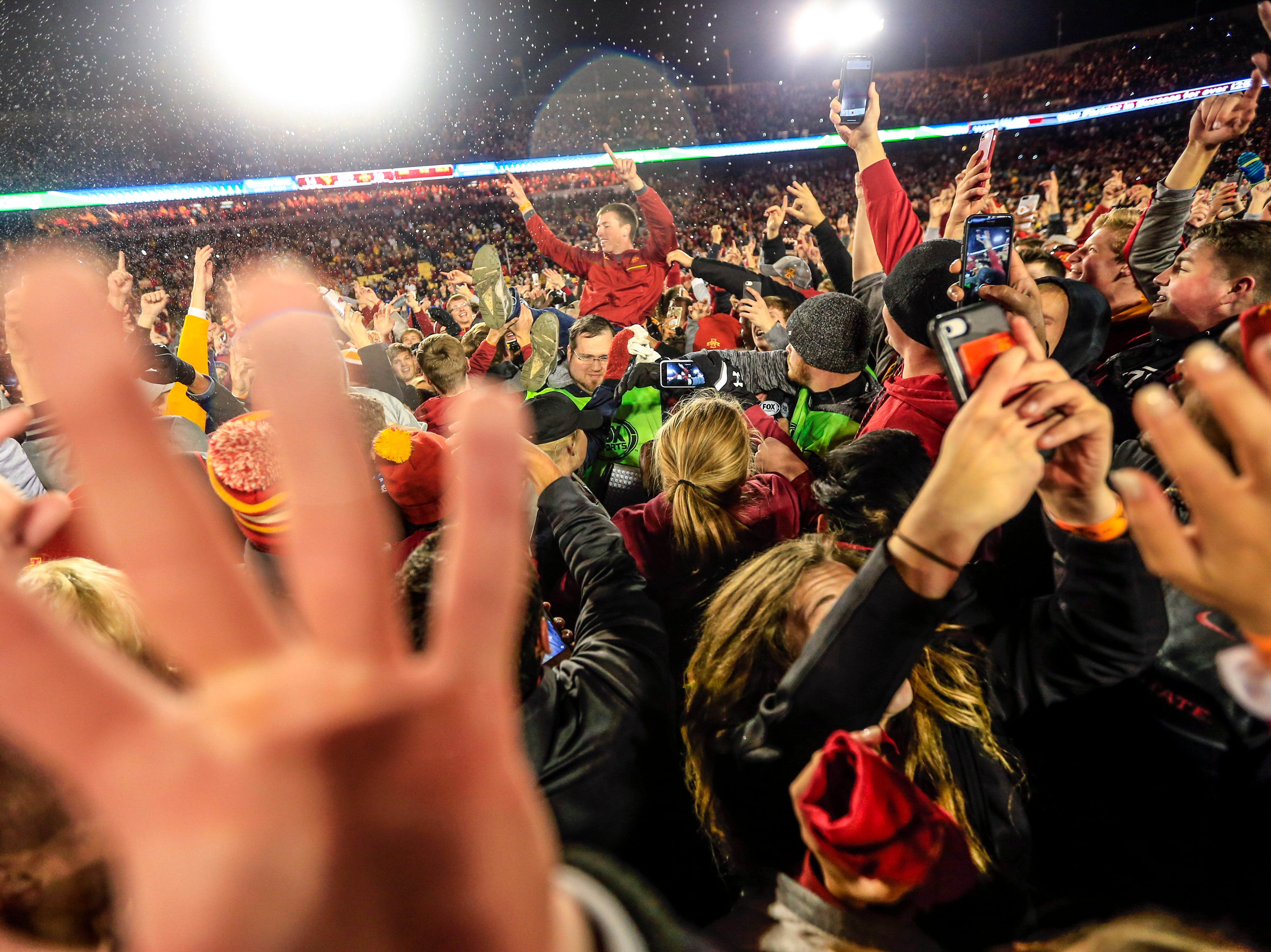 Fans rush the field after Iowa State defeats West Virginia game at Jack Trice Stadium Saturday, Oct. 13, 2018.