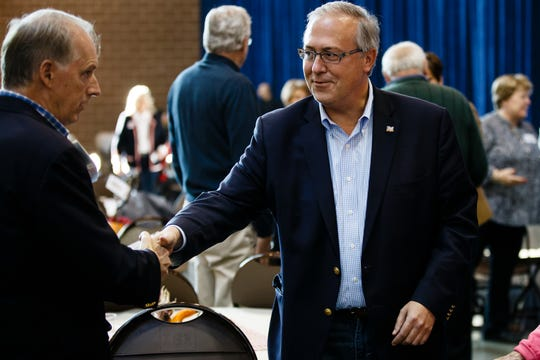 Rep. David Young greets supporters during Gov. Reynolds Harvest Festival at the Knapp Animal Learning Center on Saturday, Oct. 13, 2018, in Des Moines.