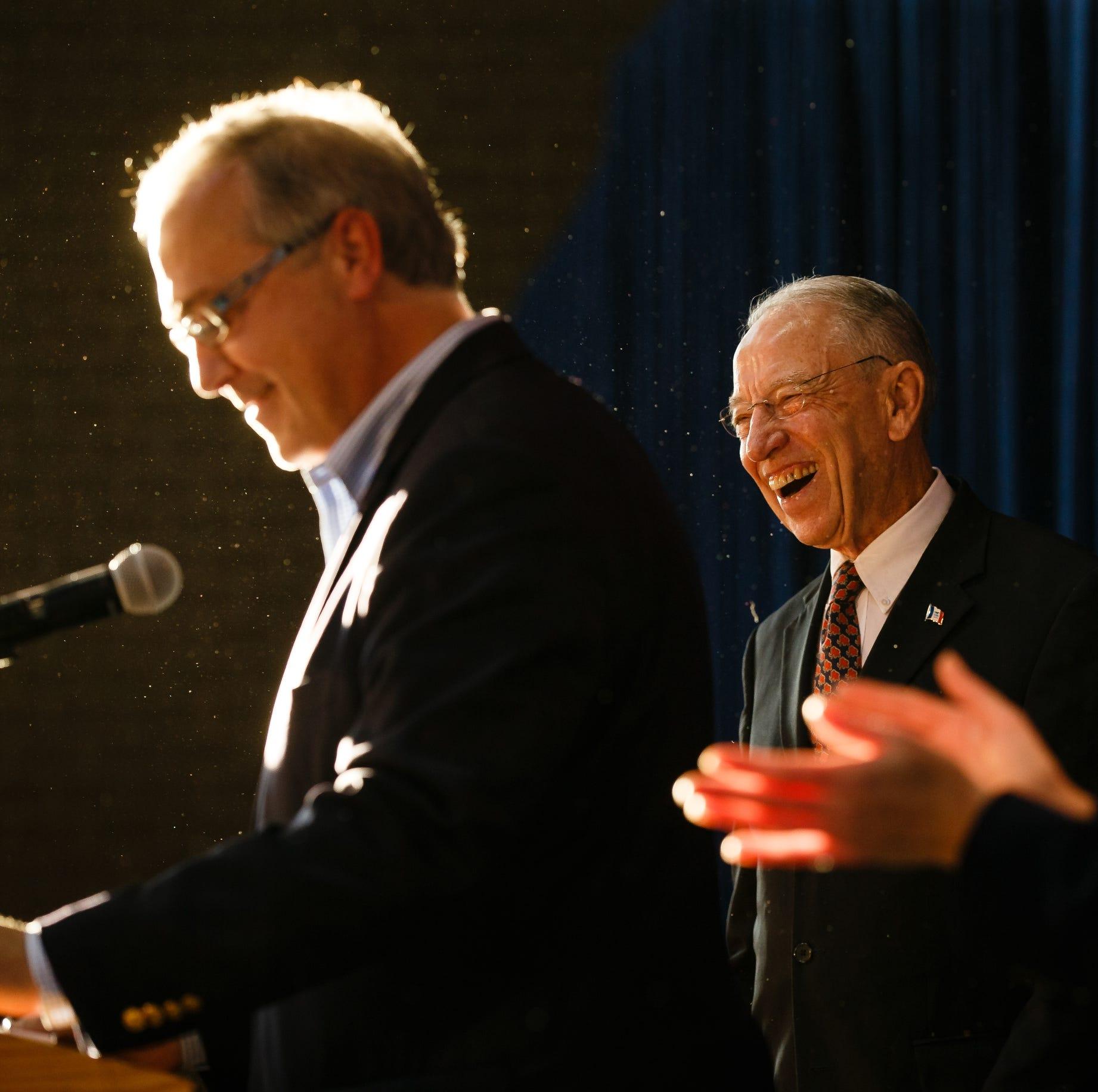 Sen. Chuck Grassley laughs at a joke as Rep....