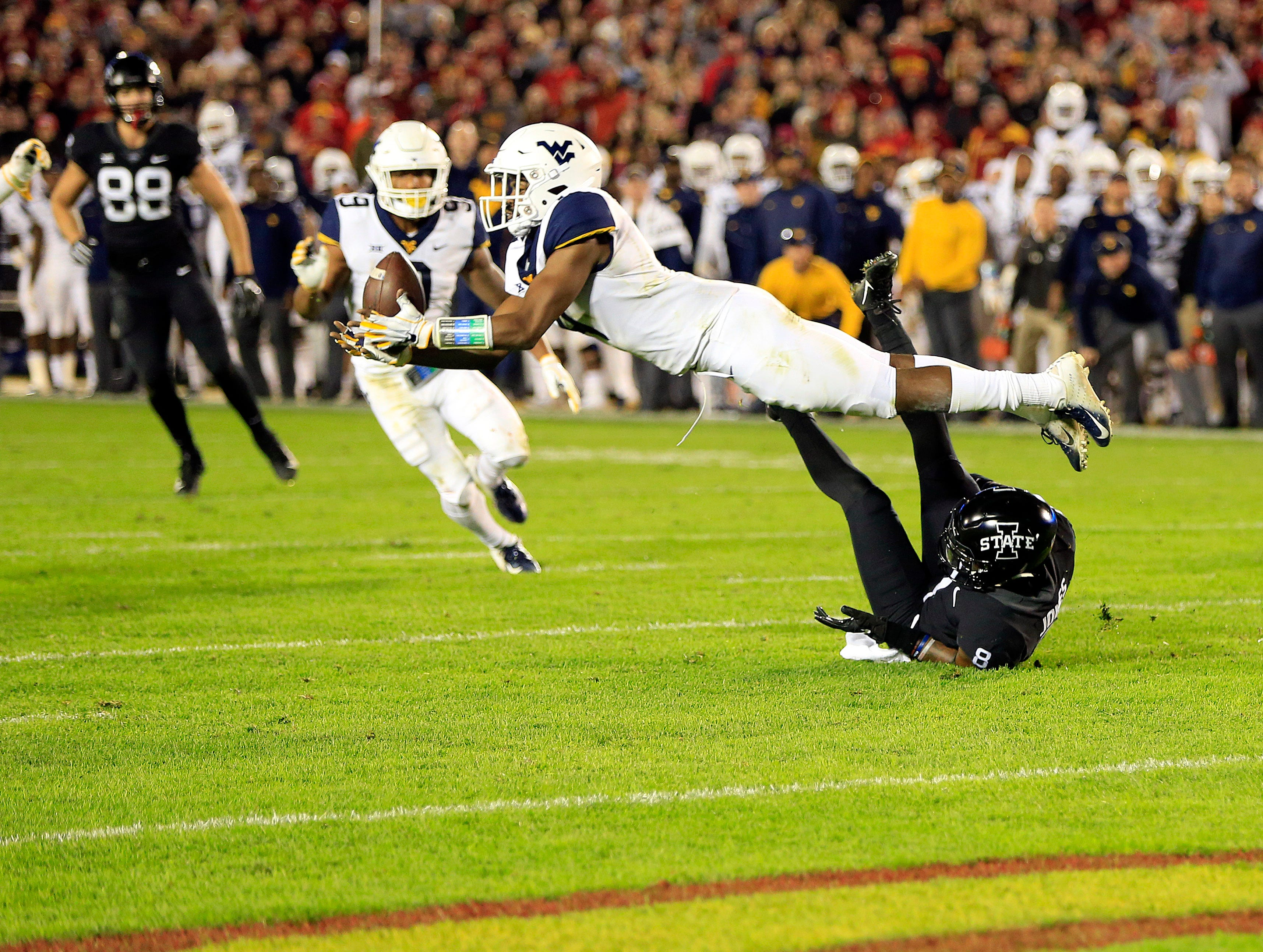 West Virginia CB Josh Norwood lays out for a near interception during the Iowa State West Virginia game at Jack Trice Stadium Saturday, Oct. 13, 2018.