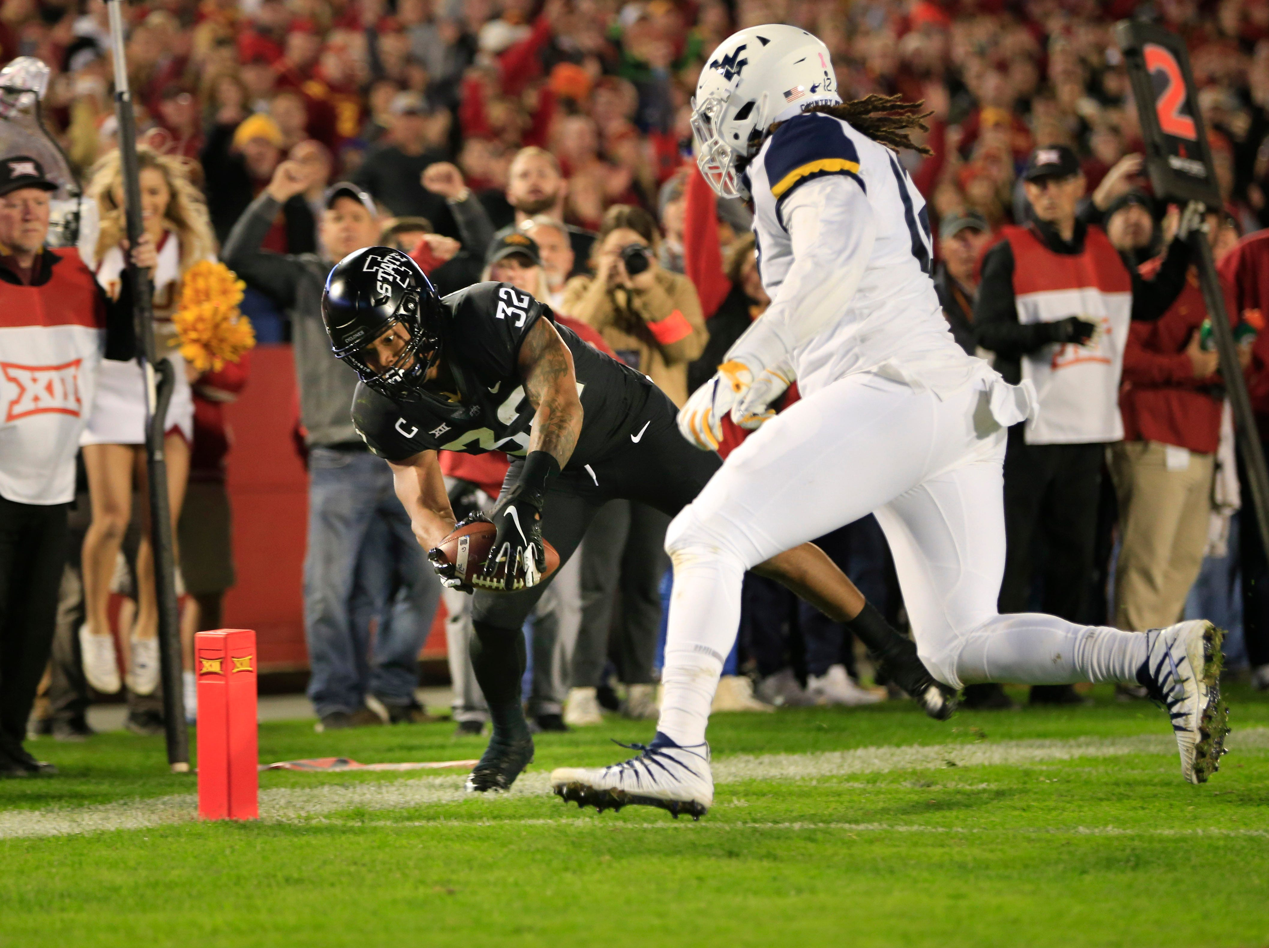Iowa State running back David Montgomery dives for the end zone during the Iowa State West Virginia game at Jack Trice Stadium Saturday, Oct. 13, 2018.
