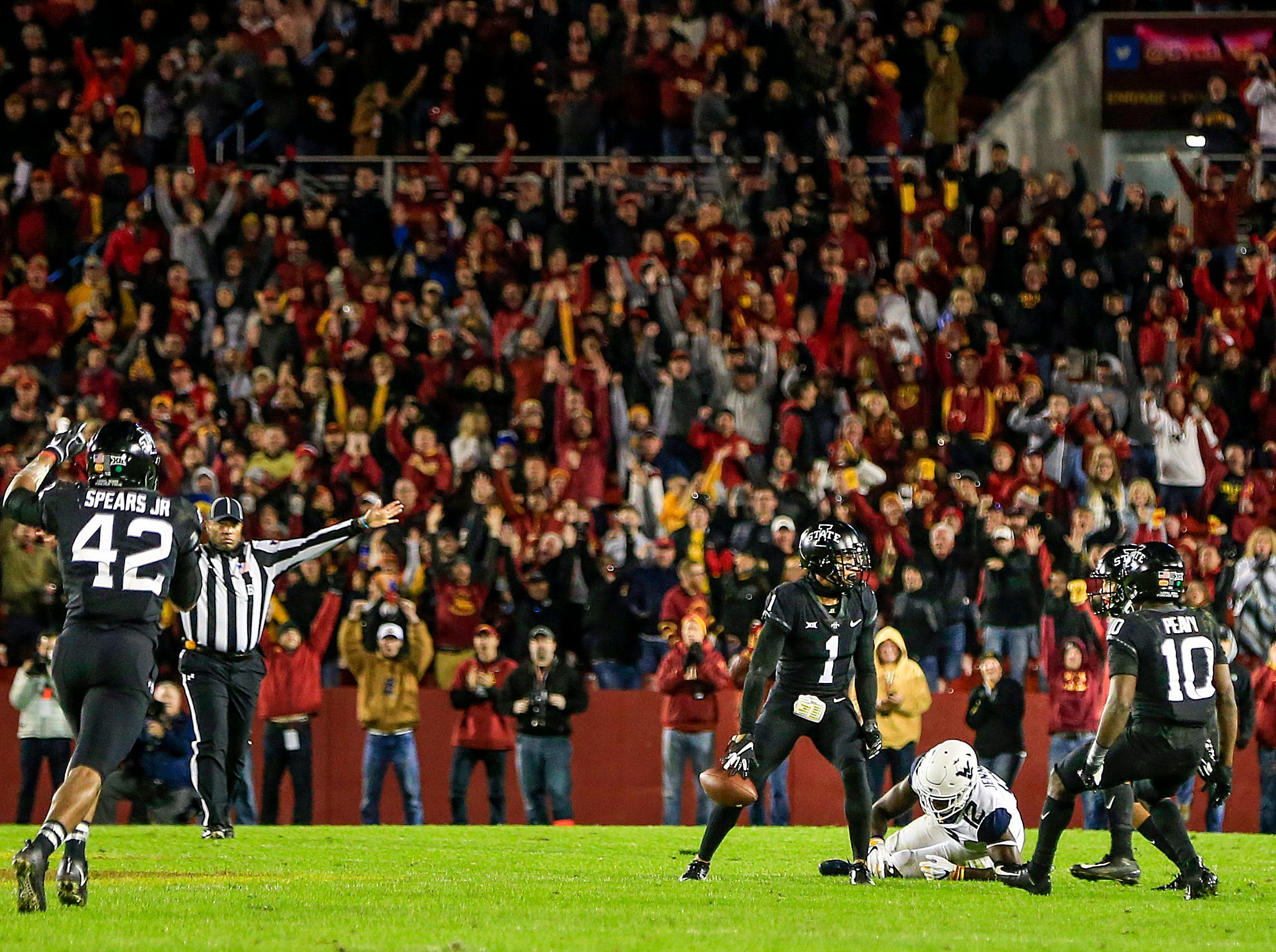 D'Andre Payne (1) intercepts a pass from West Virginia during the Iowa State West Virginia game at Jack Trice Stadium Saturday, Oct. 13, 2018.