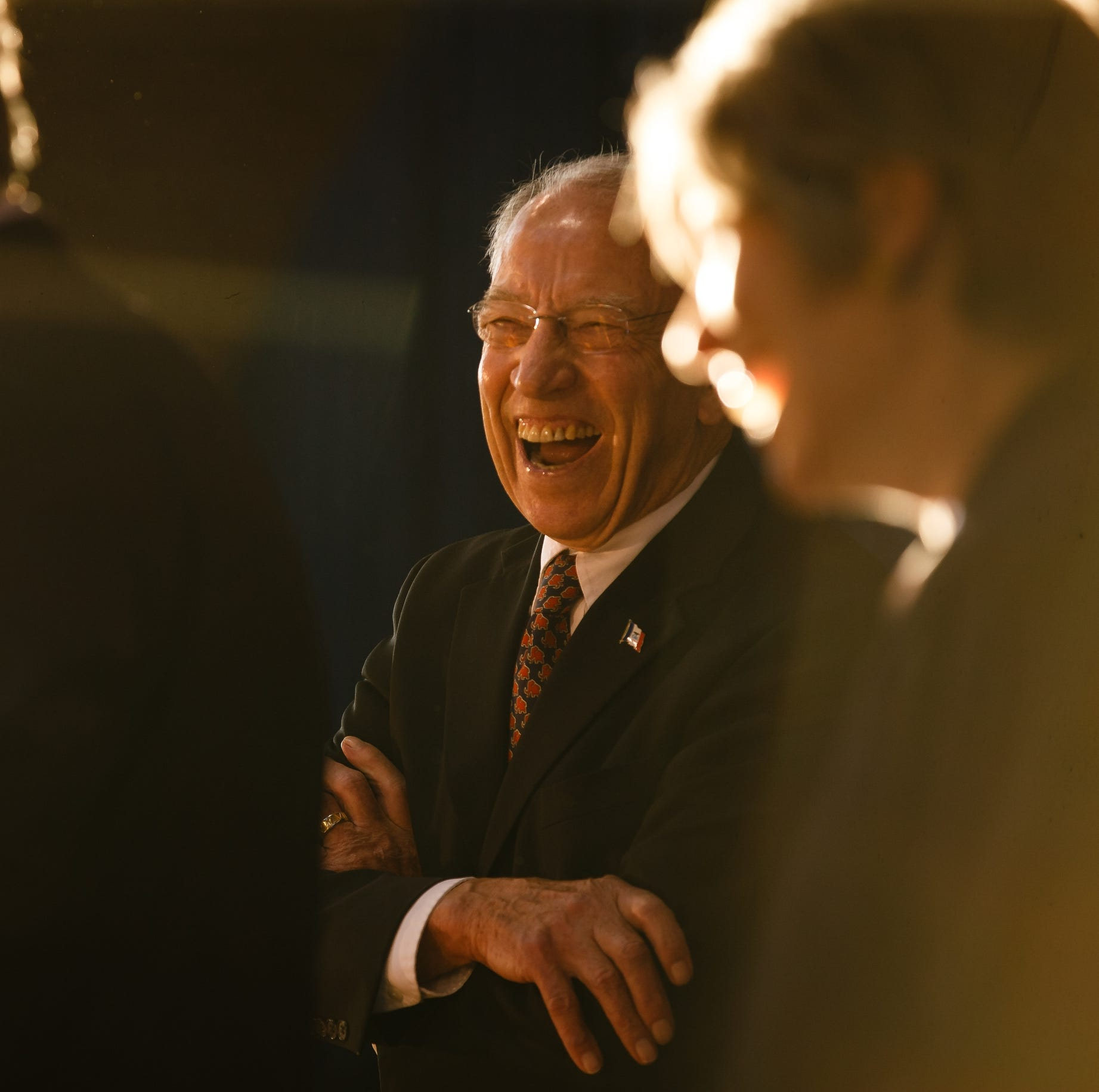Sen. Chuck Grassley laughs at a joke as Rep. David Young speaks during Gov. Reynolds Harvest Festival at the Knapp Animal Learning Center on Saturday, Oct. 13, 2018, in Des Moines.