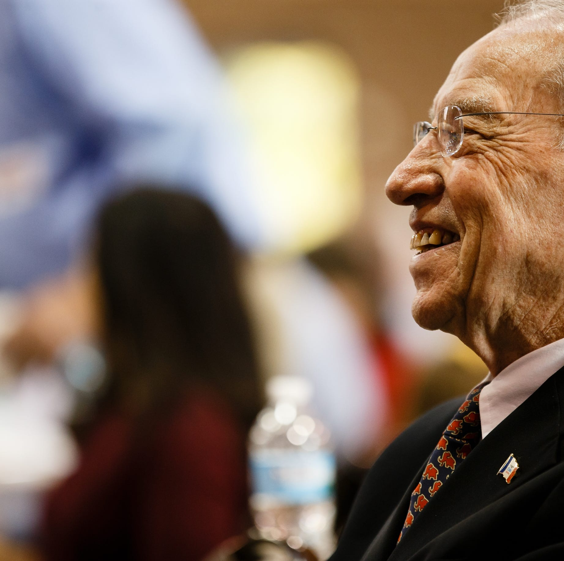 Sen. Chuck Grassley laughs as White House Spokesperson Sarah Sanders speaks during Gov. Reynolds Harvest Festival at the Knapp Animal Learning Center on Saturday, Oct. 13, 2018, in Des Moines.