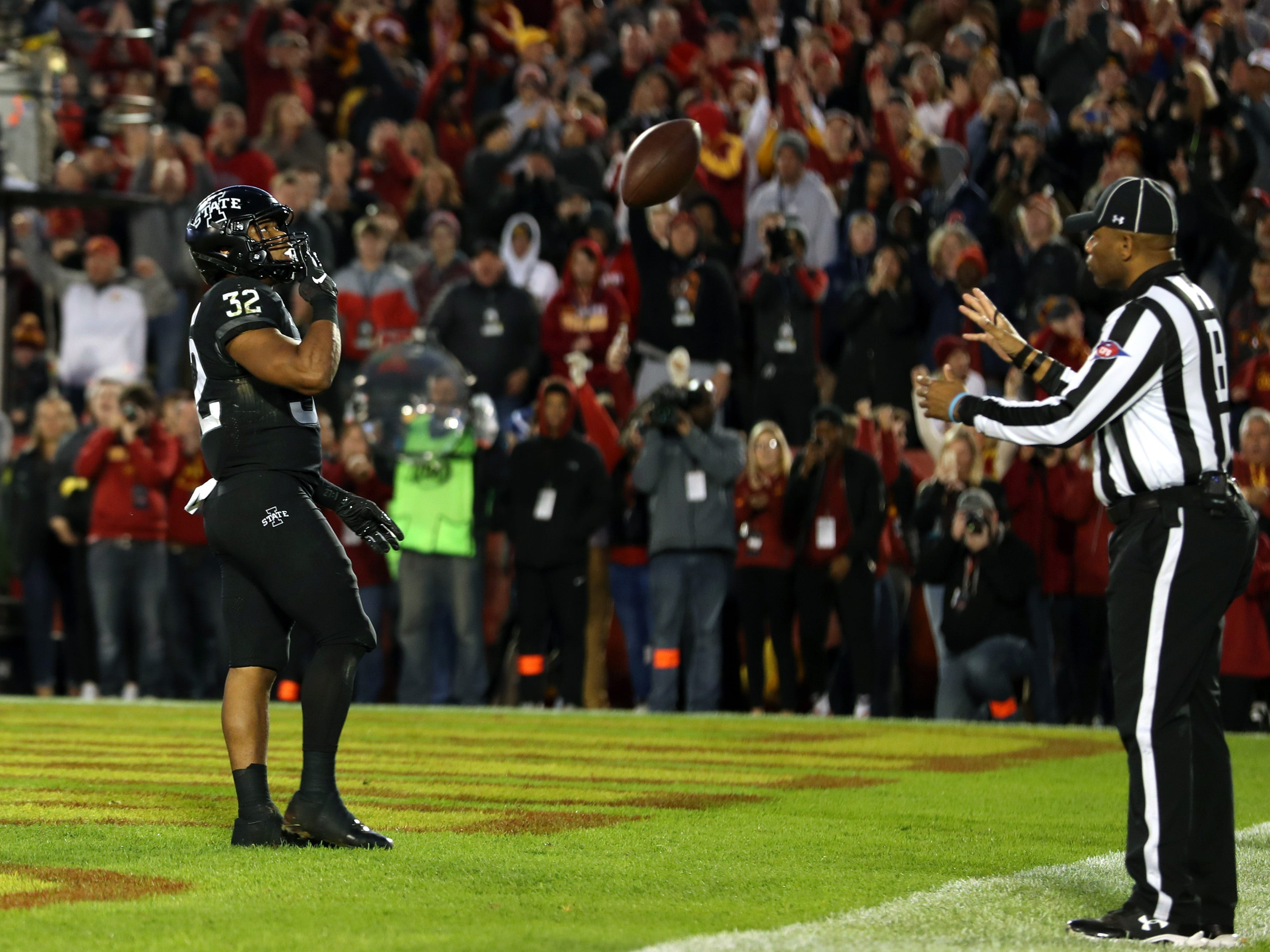 Iowa State Cyclones running back David Montgomery (32) celebrates after scoring a touchdown against the West Virginia Mountaineers at Jack Trice Stadium.