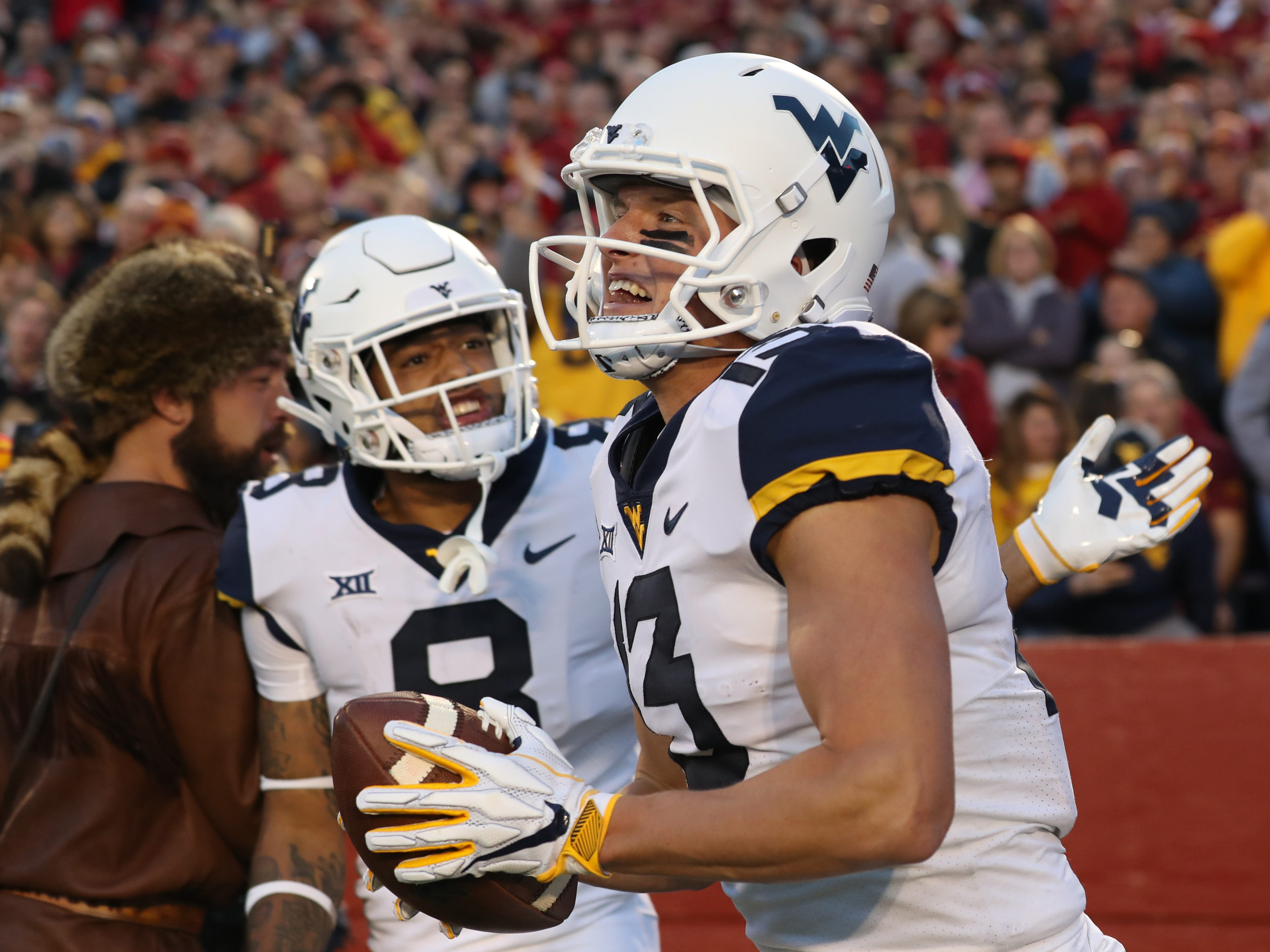 West Virginia Mountaineers wide receiver David Sills V (13) celebrates with wide receiver Marcus Simms (8) after scoring a touchdown against the Iowa State Cyclones at Jack Trice Stadium.