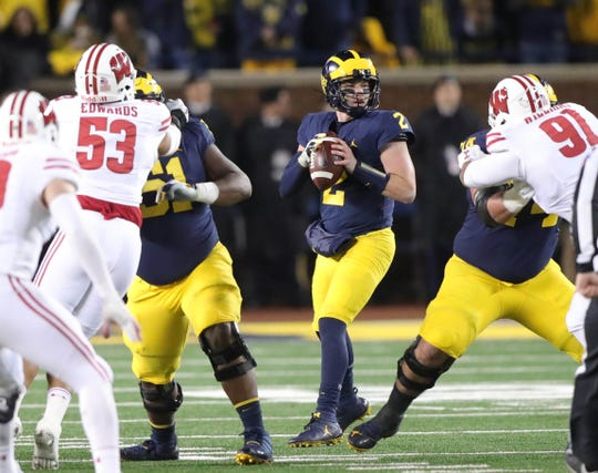 Michigan quarterback Shea Patterson looks to pass against Wisconsin during the first half Saturday, Oct. 13, 2018 at Michigan Stadium in Ann Arbor.