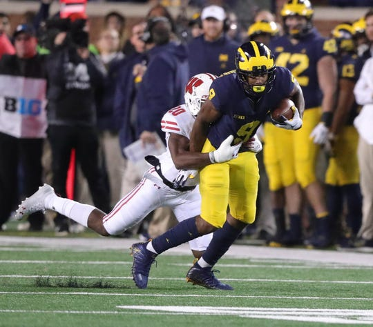 Michigan receiver Donovan Peoples-Jones is tackled by Wisconsin defensive back Faion Hicks during the first half Saturday, Oct. 13, 2018 at Michigan Stadium in Ann Arbor.