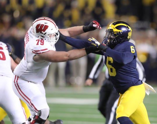 Michigan linebacker Josh Uche rushes against Wisconsin lineman David Edwards during the first half Saturday, Oct. 13, 2018 at Michigan Stadium in Ann Arbor.