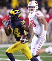 Michigan cornerback Lavert Hill runs for a touchdown off an interception against Wisconsin in the second half Saturday, Oct. 13, 2018 at Michigan Stadium in Ann Arbor.