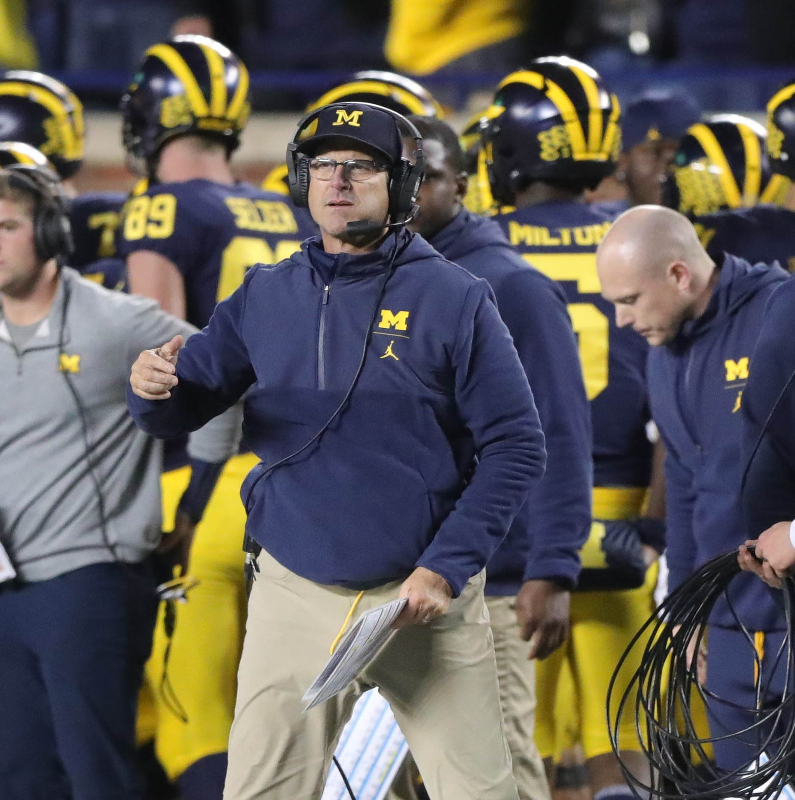 Jim Harbaugh doesn't talk game plan, injuries in news conference