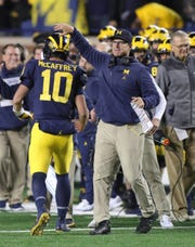 Michigan head coach Jim Harbaugh with  Dylan McCaffrey during the second half against Wisconsin, Saturday, Oct. 13, 2018 at Michigan Stadium in Ann Arbor.