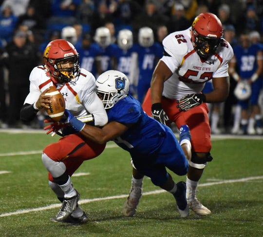 Ferris State quarterback Jayru Campbell is tackled by a Grand Valley State defender Saturday, Oct. 13, 2018 at Lubbers Stadium in Allendale.