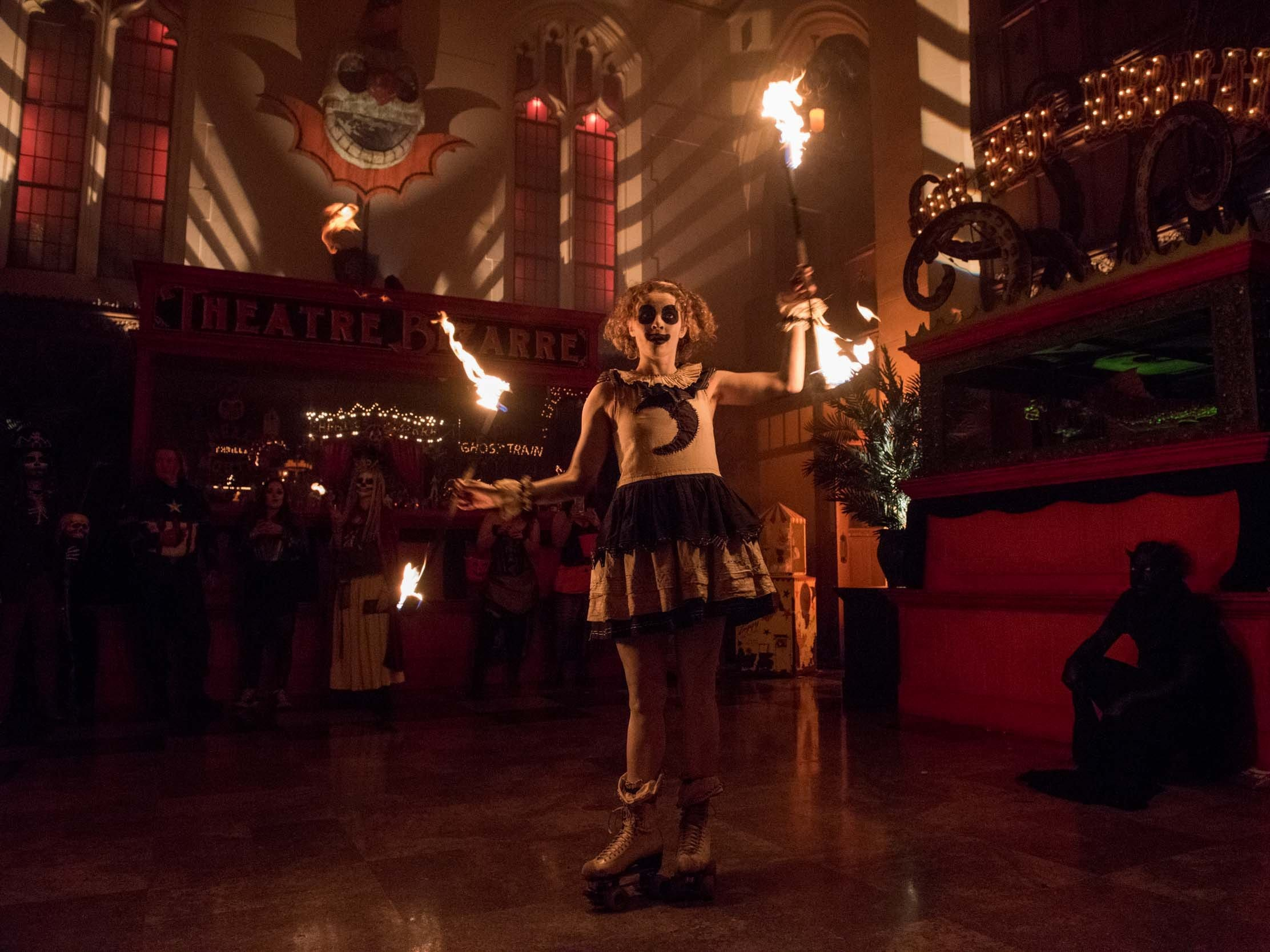 Olive Marie performs for the crowd in the main lobby during Theatre Bizarre at the Masonic Temple on October 13, 2018.