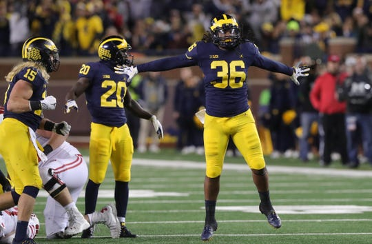 Michigan linebacker Devin Gil celebrates after a tackle during the second half against Wisconsin, Saturday, Oct. 13, 2018 at Michigan Stadium in Ann Arbor.