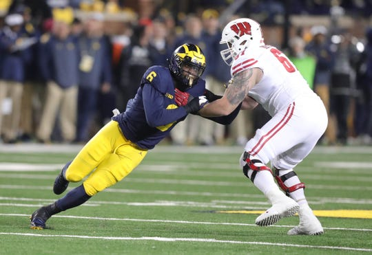 Michigan's Josh Uche rushes against Wisconsin lineman Jon Dietzen during the second half Saturday, Oct. 13, 2018 at Michigan Stadium in Ann Arbor.