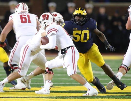 Michigan defensive lineman Michael Dwumfour rushes Wisconsin quarterback Alex Hornibrook during the first half Saturday, Oct. 13, 2018 at Michigan Stadium in Ann Arbor.